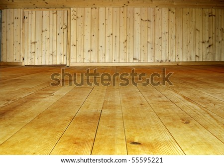 Carpenter work with wood of the wall and the floor