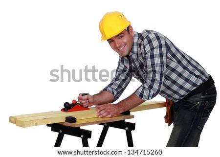 carpenter working on workbench - stock photo
