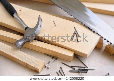carpenter working with hammer and nails  - stock photo