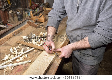 carpenter working with plane on wooden - stock photo