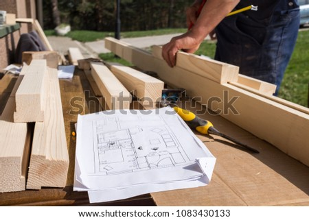 Carpenter working technical drawing blueprint construction stock carpenter working with technical drawing or blueprint construction paper lying on a workshop outdoor desk malvernweather Images