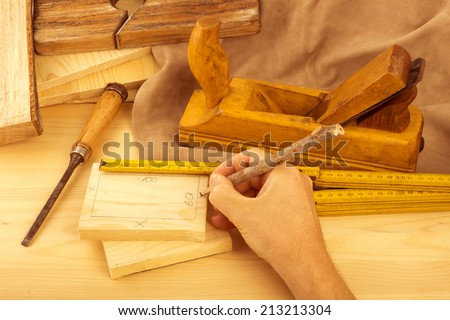 Carpenter workshop, processing wood with smoothing plane and wood chisel - stock photo