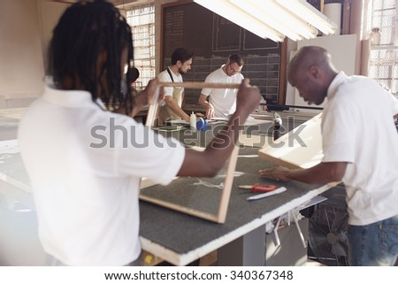 Carpenters making frames in their workshop