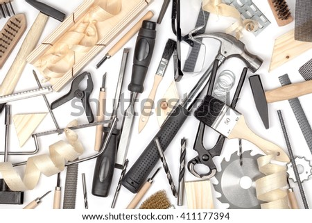 carpentry and woodwork tools on white background. carpenter working table. creative mess composition top view - stock photo