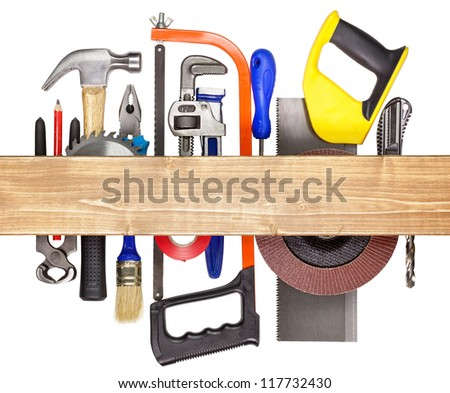 Carpentry, construction hardware tools underneath the wood plank. - stock photo