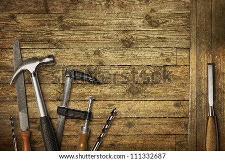 Carpentry hand tools set on old wooden background