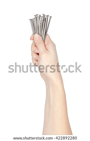 carpentry iron nails in a hand isolated on white background. carpenter tool - stock photo