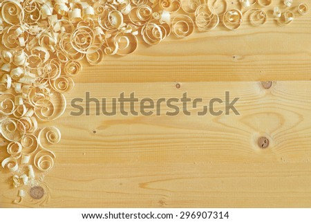 Carpentry motif.  Wooden background with decorative corner of curly shavings. - stock photo