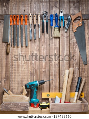 Carpentry tools hanging on the wall. - stock photo