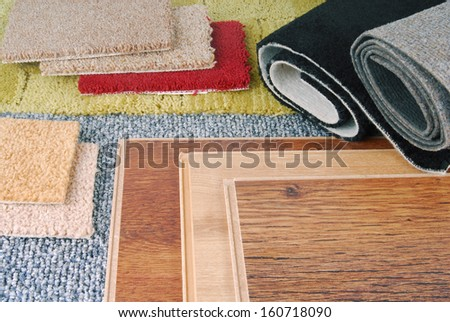 carpet and laminate choice for interior - stock photo
