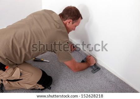 Carpet fitter - stock photo