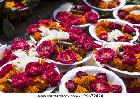 carpet of colorful plates of flowers and candles - stock photo
