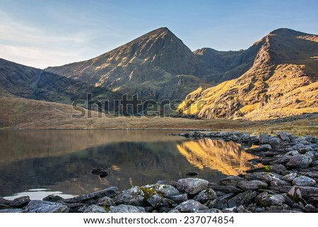Carrauntoohil, the tallest peak in Ireland reflected in a calm lake - stock photo