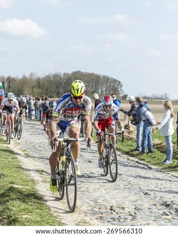 CARREFOUR de l'ARBRE,FRANCE- APR 12:Peter Sagan of Tinkoff-Saxo, and Alexander Kristoff of Katusha,riding on the cobblestone sector Carrefour de l'Arbre during the Paris Roubaix 2015 race. - stock photo