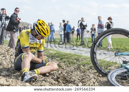 CARREFOUR de l'ARBRE,FRANCE- APR 12: The Belgian cyclist Tom Van Asbroeck of LottoNL-Jumbo Team crashed at high speed in the difficult sector Carrefour de l'Arbre during the Paris Roubaix 2015 race.  - stock photo
