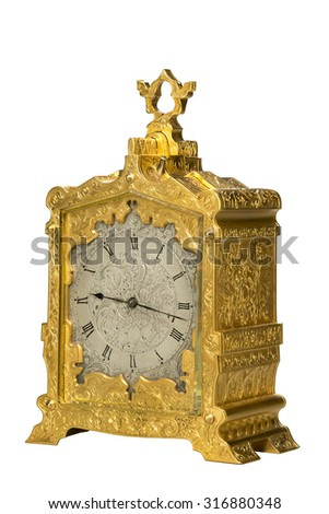 Carriage clock brass with carrying handle sometimes taken when traveling isolated on white - stock photo