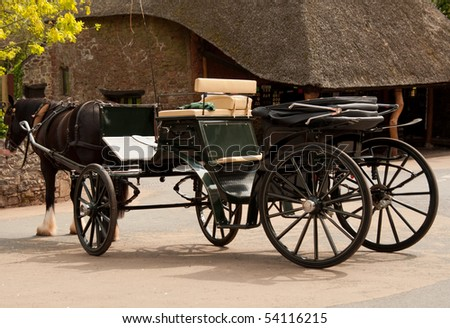 Carriage drawn by a shire horse - stock photo