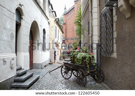 Carriage with flowers in one of the Riga streets. - stock photo