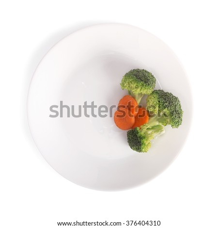 carrot and broccoli in plate, isolated on white background