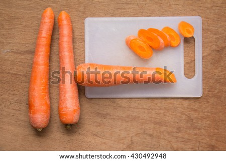 Carrot and some sliced on cutting board