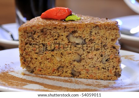 Carrot cake dessert with coffee at the background - stock photo