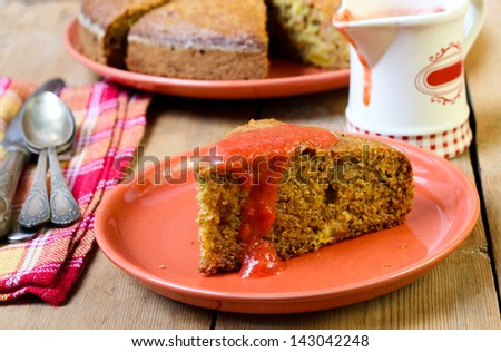 Carrot, courgette cake with berry sauce