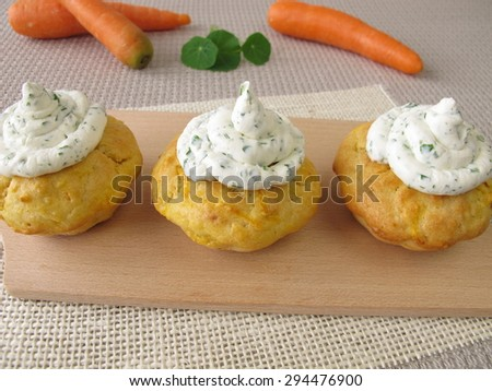 Carrot cupcake with herb cream cheese - stock photo
