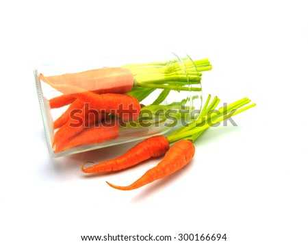 carrot in jar on white background