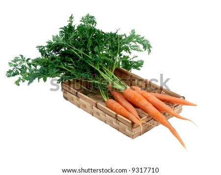 carrot on the basket on the white background - stock photo