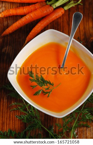 carrot soup in big white bowl - stock photo