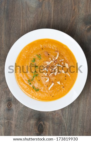 carrot soup with almonds, top view, vertical