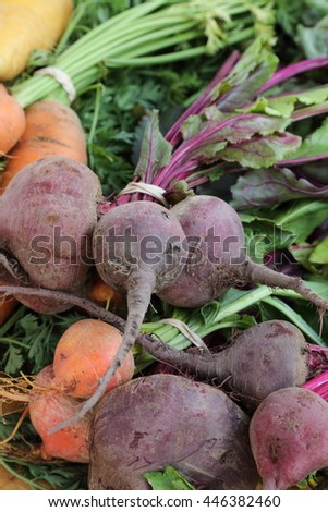 Carrots and beets on a table at a farmers market