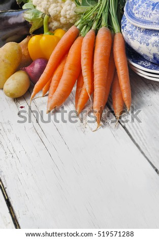 carrots and other vegetables for potage on a white table