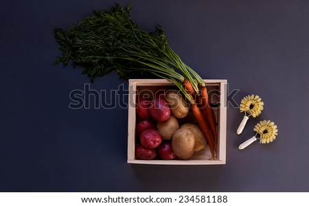 Carrots and Potatoes with Vegetable Brushes