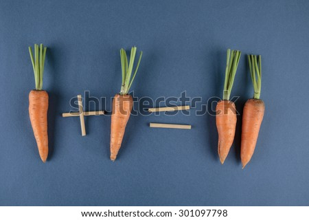carrots and school mathematics with math problems - stock photo