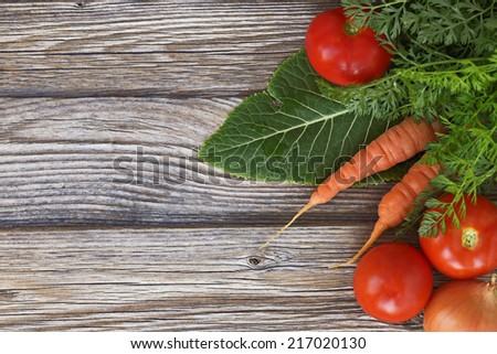 carrots and tomatoes on the table