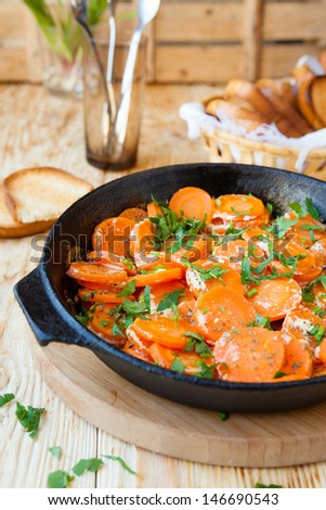 carrots baked with cream in a pan, food