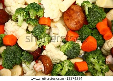 Carrots, cauliflower, broccoli, mushrooms and parsnip background. - stock photo