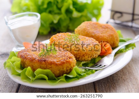 Carrots cutlets on white plate and sauce - stock photo