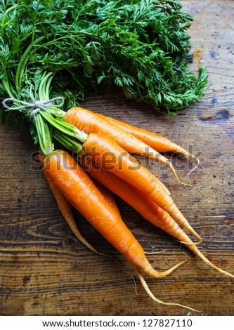 carrots on a wooden background - stock photo