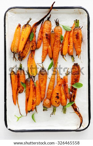 carrots on baking sheet, food top view - stock photo