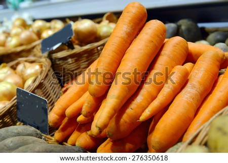 carrots on display at a supermarket - stock photo
