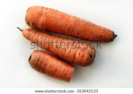 Carrots whole and cut on white background top view