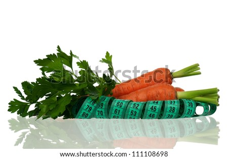 Carrots with parsley and tape measure on white - stock photo