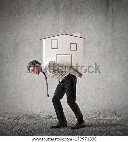 carrying a house - stock photo