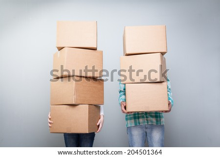 carrying and lifting boxes - stock photo