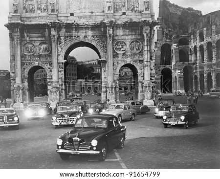 Cars and ancient monuments Rome Italy - stock photo