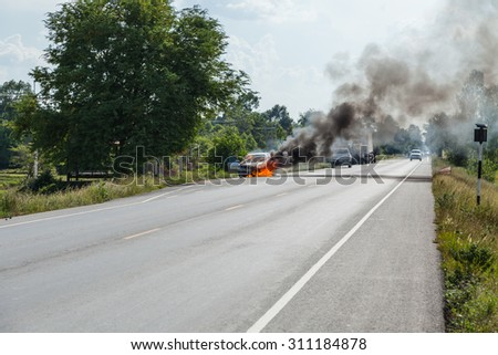 Cars are being burned on the streets. - stock photo