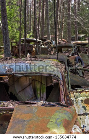 Cars at a car cemetery - stock photo