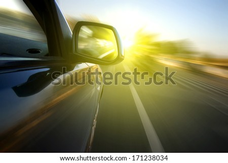 Cars at sunset highway - stock photo